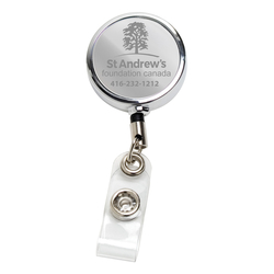 RETRACTABLE BADGE REEL AND BADGE HOLDER
